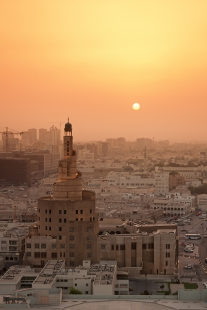 a mosque building viewed with the setting sun in a yellow haze photo