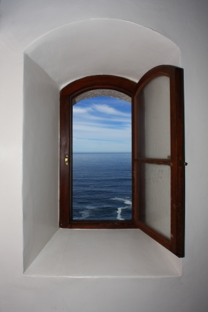 window view of blue seascape and sky Stock Photo