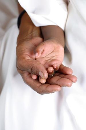 black caring hands nurturing a child s hand