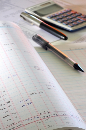calculating written accounts book adding expenses