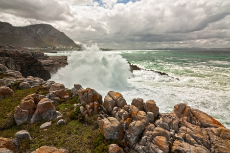 ocean waves crashing against coastal rocks