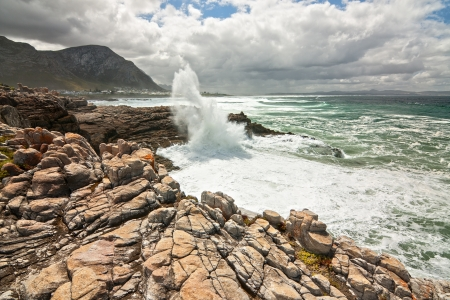 ocean shoreline with dramatic rocks waves action white water and spray Stock Photo - 16685390