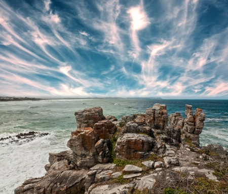 rocky outcrop on a bright sea shoreline with dramatic sky Stock Photo - 16685383