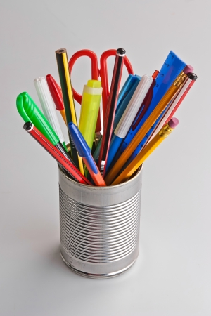 office and school stationary grouped in a metal tin can organiser Stock Photo