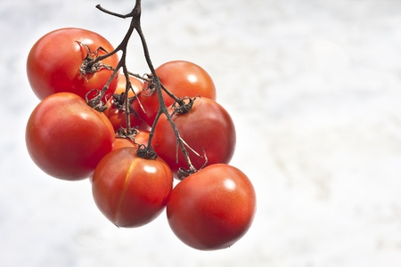 hanging bunch of ripe red tomatoes Stock Photo