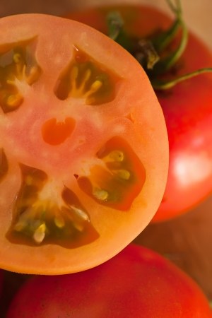 red tomato detail showing cross section of inside with pips