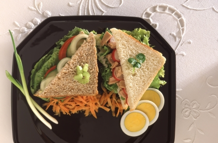 tuna salad sandwich with egg on a black plate Stock Photo