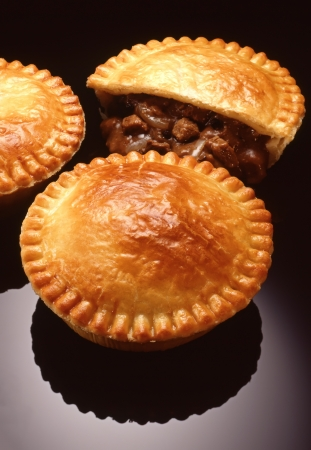 meat pie displayed with meat and gravy showing