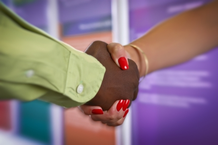 black empowerment: male female handshake across gender  Stock Photo