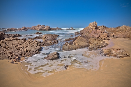 ocean beach with rocks and water  Stock Photo