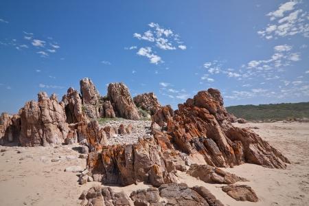 rocky outcrop along a deserted beach