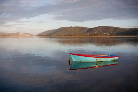 small row boat moored in calm lagoon water Stock Photo - 16811923