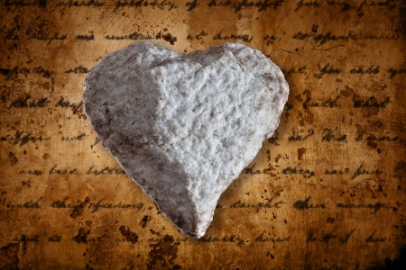 heart of sone on a textured background with writings of a love letter Stock Photo