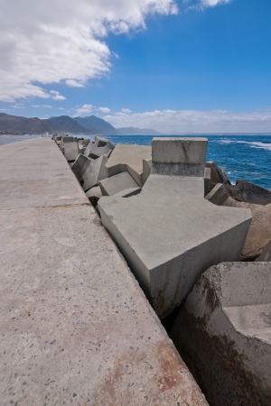 concrete arrows used to protect a harbor pier from wave erosion
