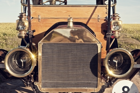 details of the grill of a vintage motor vehicle showing lights
