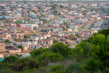 distant view of housing in an informal african shanty town township Stock Photo