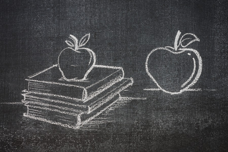 educated: educated apples learned apples on top of books, white chalk on a blackboard