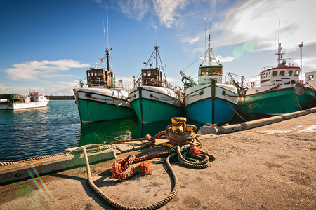 fishing boats at anchor in a small harbor ocean bay