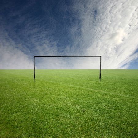 Its a football pitch, with white clouds Stock Photo