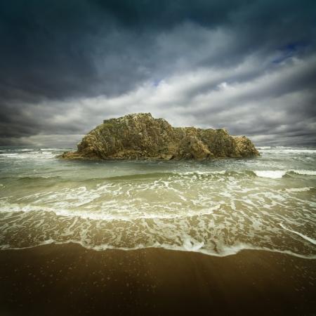 big rock in the stormy ocean