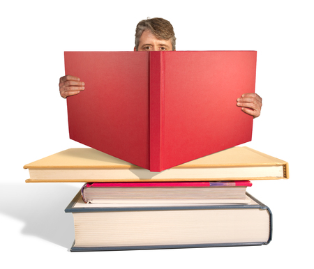 intellectually: Man reading a stack of big books