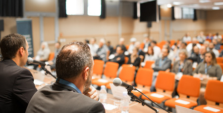 Speaker at Business conference with audience