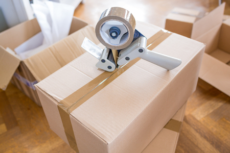 Close-up of Tape and Packaging Cards - House Moving Concept