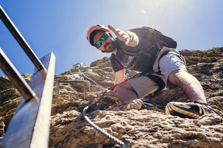 Climbing concept Teamwork helping hand