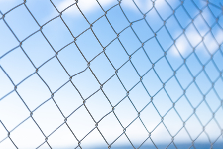 fence with blue sky behind Stock Photo