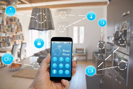 Smart home concept, hand holding smart phone with smart home application on screen Reklamní fotografie