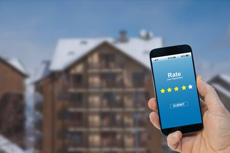 Application rating concept - Person rating with smartphone on screen