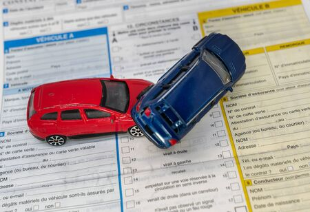 car insurance report following an accident concept with toy cars 写真素材