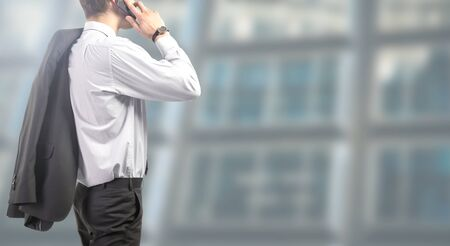 businessman standing relaxed phones