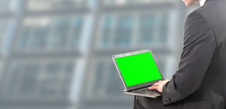 businessman sitting on a laptop screen 写真素材 - 134748810