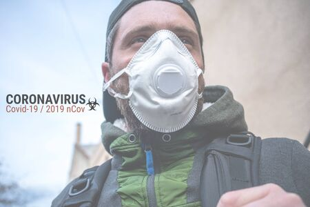 Man with protective medical mask FFP2 against virus Covid-19 or coronavirus