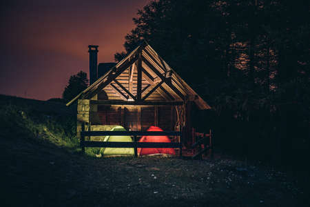 Wooden shelter in mountain, long exposure shot at night - Stars and milky way background