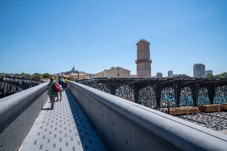 Mucem museum footbridge with tourists, view of Fort St Jean, Museum of Civilizations of the Sea - Marseille France