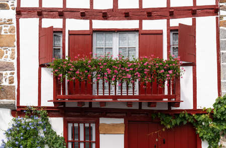 Traditional Basque house with red woodwork, french culture, France Travel