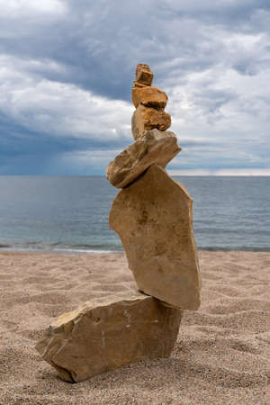 Zen balanced stack of stones on beach - Perfect for zen poster edition