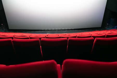 Empty red seats in a cinema auditorium