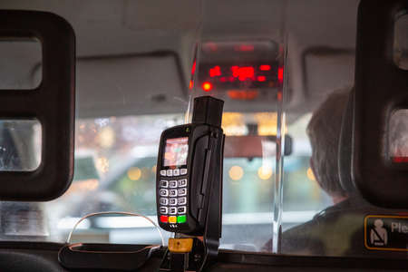 Credit card terminal in taxi car