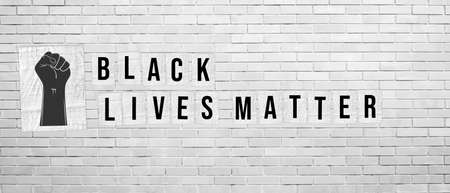 Black Lives Matter. Illustration with words written on paper posters on white brick wall background. Protest against racism and social inequality concept. For social media, web, banner