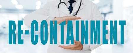 Doctor Man holding in his hands re-containment title, on Hospital background - Horizontal banner Reklamní fotografie