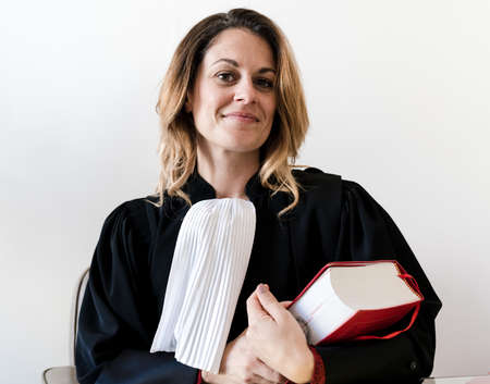 lawyer holding red law book - Young beautiful woman lawyer