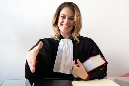 Justice, lawyer reaches out with a smile - Young beautiful caucasian woman