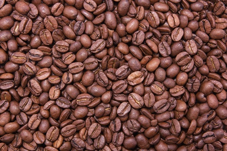 コーヒーから茶色の背景。コーヒー豆 Arabika