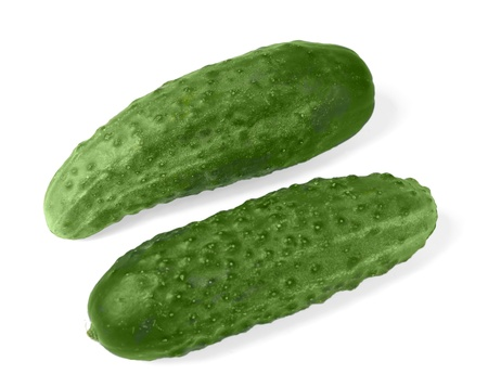 unsliced: Two cucumber isolated on white background
