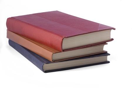 白い背景の上の書籍のスタック。