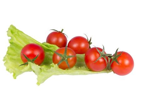 赤いトマトと白い背景の上のサラダ 写真素材