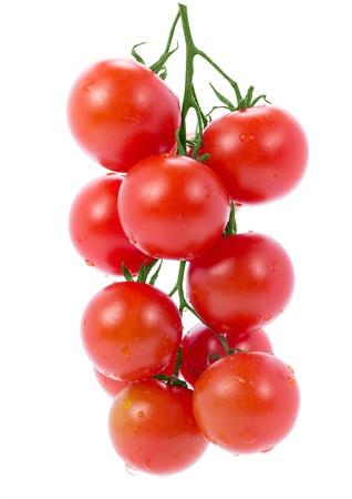 tomate cherry: Subdivisi�n de los tomates cereza aisladas sobre fondo blanco Foto de archivo